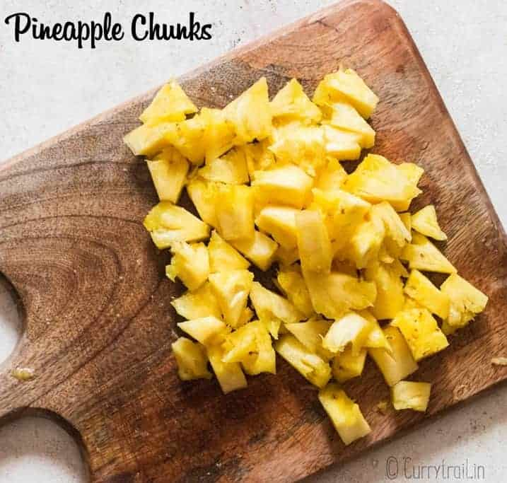 chunks of cut pineapple on wooden board