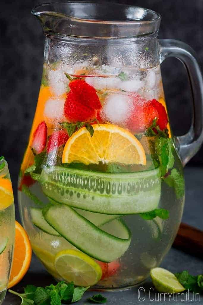 Refreshing homemade infused water in pitcher