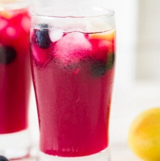 icy cool refreshing lemonade with blueberries served in two glasses
