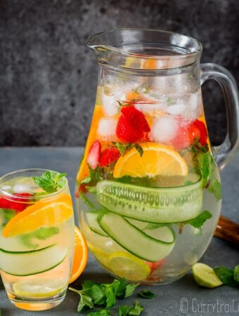 detox fruit infused water in pitcher and glass