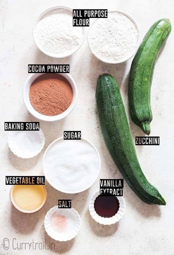 all ingredients for zucchini brownies placed on white board