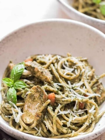 chicken pesto pasta served in ceramic bowl