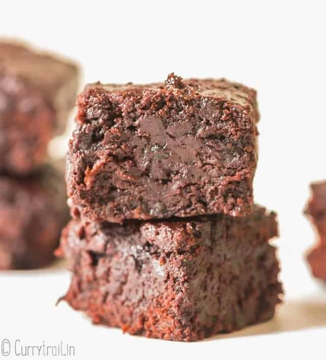 moist brownies made from zucchini stacked one on top of other