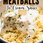 juicy meatballs in creamy white sauce in while bowl over pasta with text