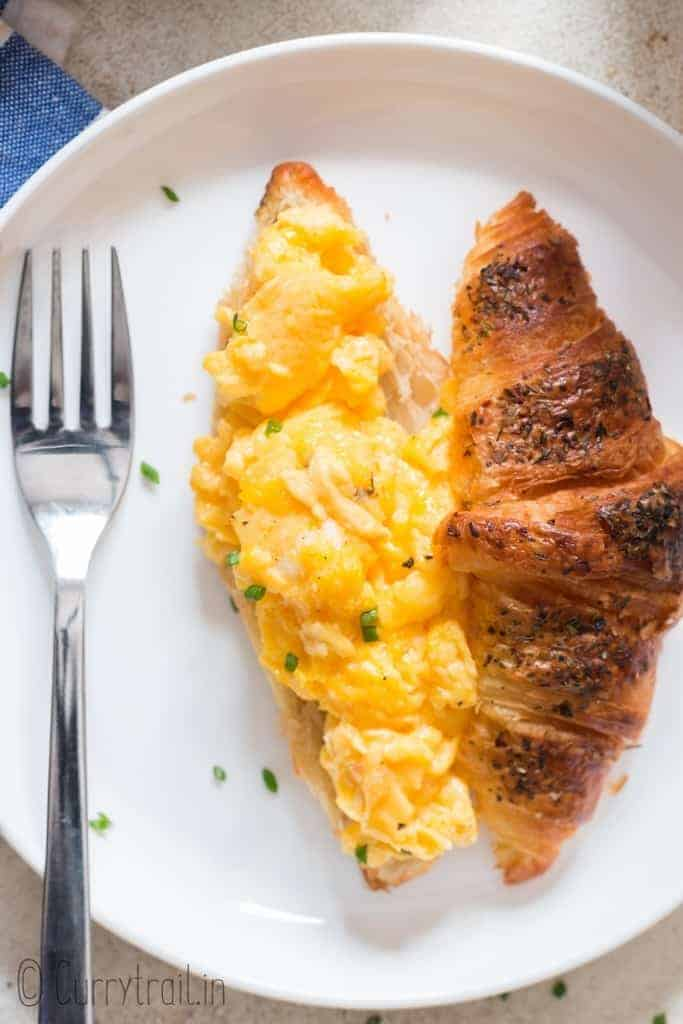 creamy egg scramble on croissant bread