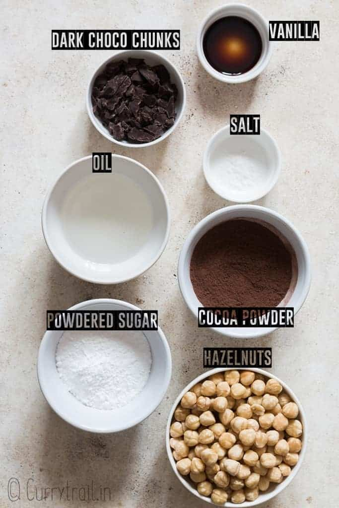 all ingredients to make homemade Nutella on white board