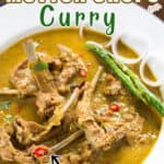 spicy green mutton chops curry in white plate with text
