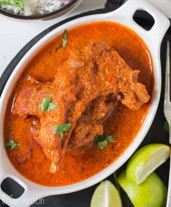chettinad spicy mutton chops in oval bowl with lemon on side