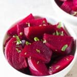 chopped soft tender beets cooked in instant pot in white ceramic bowls