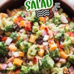 the best broccoli salad in wooden salad bowl with text