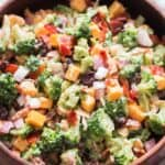 healthy broccoli salad in wooden bowl with napkin on side