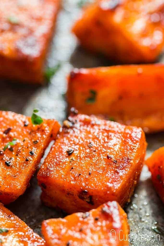 roasted sweet potatoes on baking tray with text