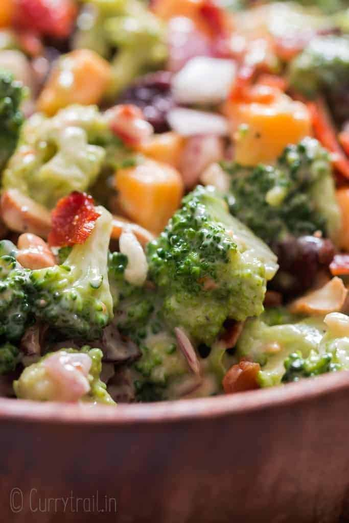 healthy broccoli salad in wooden bowl with napkin