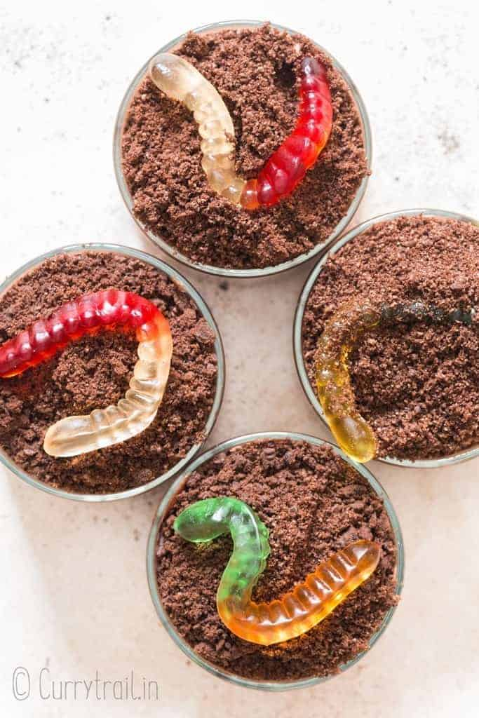 OREO chocolate pudding dirt cups in 4 small pudding glasses with gummy worms on top