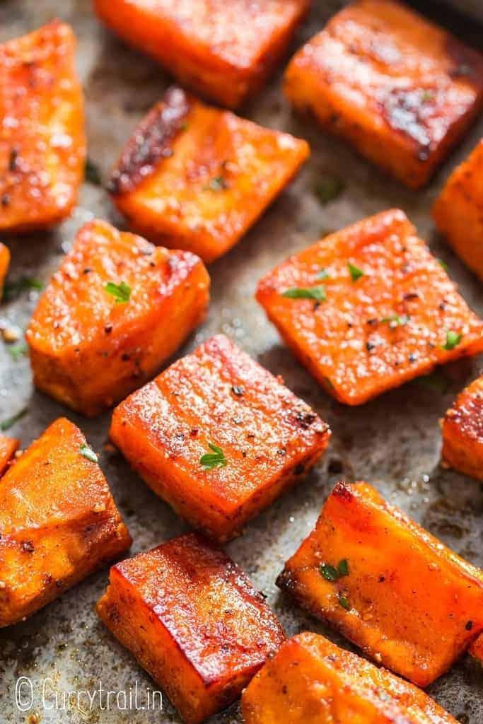 spicy and savory sweet potato roast on baking tray