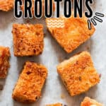 baked homemade croutons on baking tray with text