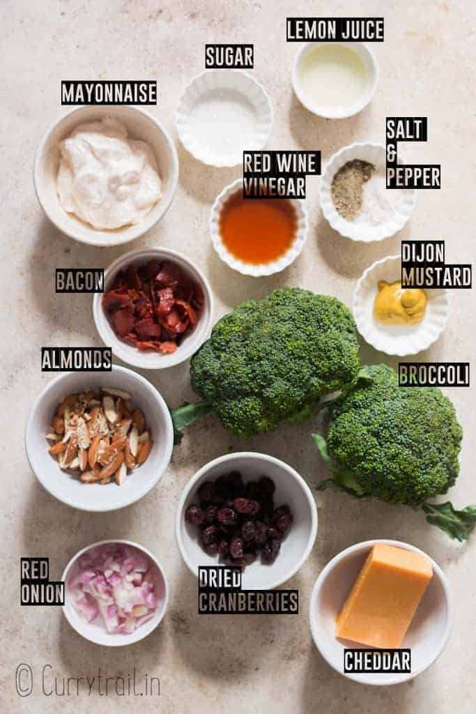 ingredients for healthy salad using broccoli on white board