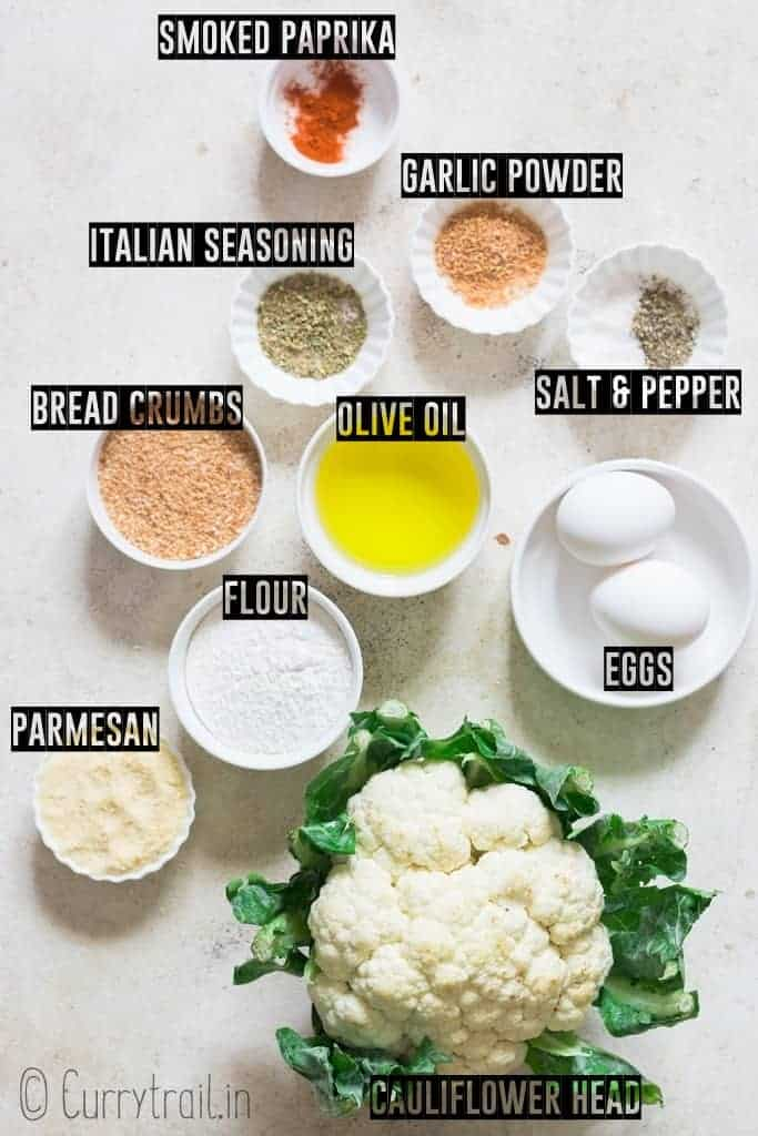 all ingredients to make oven roasted cauliflower popcorn on a board