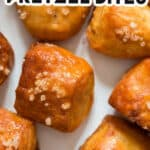 homemade soft pretzel bites on white plate with cheese sauce with text overlay