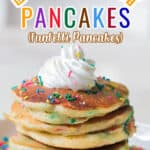 funfetti cake pancakes on white plate with whipped cream with text overlay