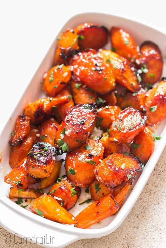 easy roasted carrot side dish in white serving bowl