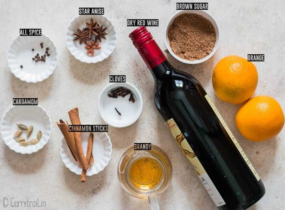 all ingredients for traditional mulled wine recipe on white board