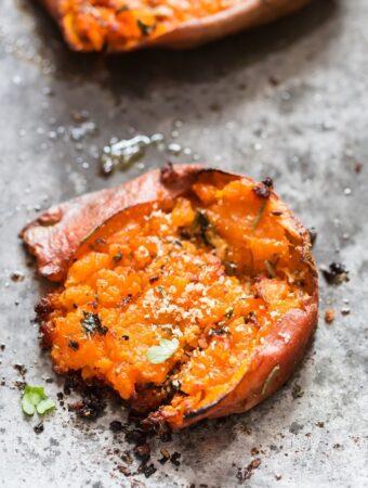 crispy and creamy smashed sweet potatoes on baking tray