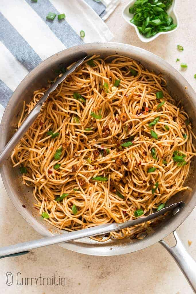 chili garlic noodles cooked in a skillet