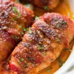 chicken breast wrapped with fatty bacon and baked until caramelized to perfection in baking dish