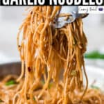 chili butter garlic noodles in wok with text