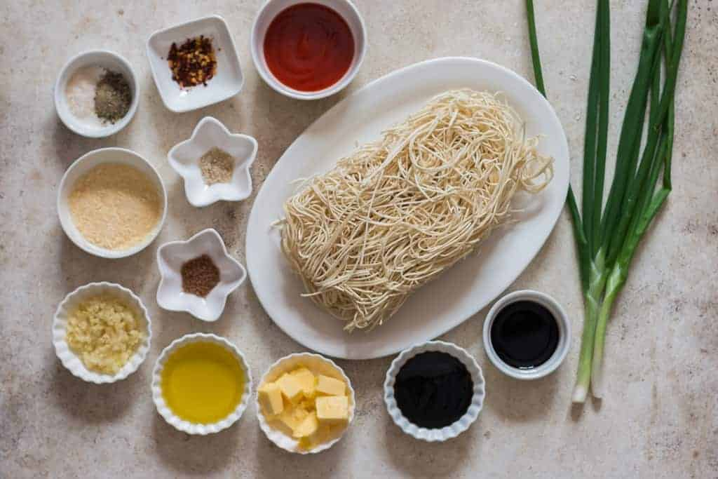 all ingredients for chili garlic noodles on white board