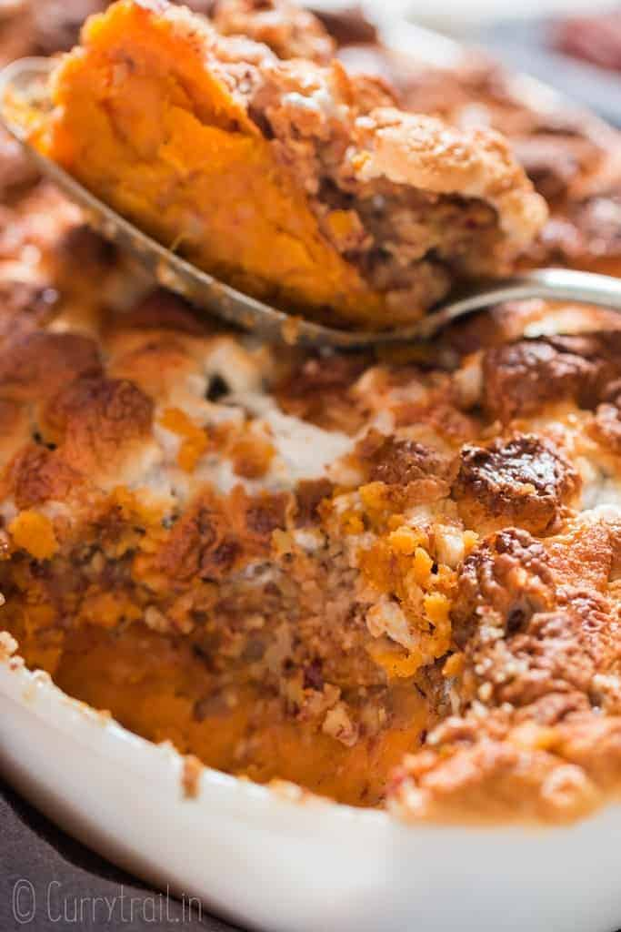 easy sweet potato casserole dish with mini marshmallow and pecan crumb topping in casserole dish