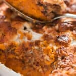 Thanksgiving casserole with sweet potatoes, pecan crumb and mini marshmallows with text overlay