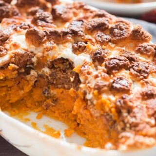 easy sweet potato casserole dish with mini marshmallow and pecan crumb topping in casserole dish with text overlay