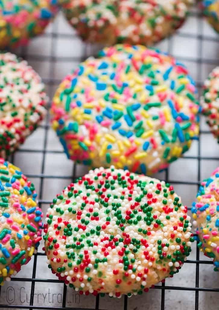 baked rainbow sprinkle sugar cookies cooling on wire rack