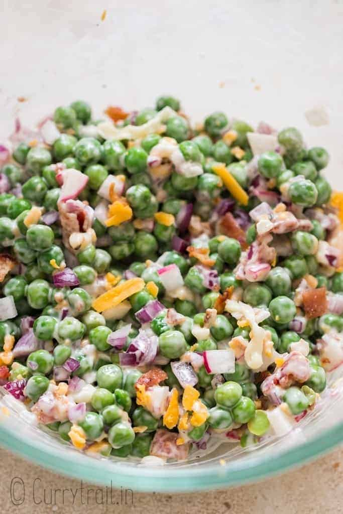making pea salad in salad bowl