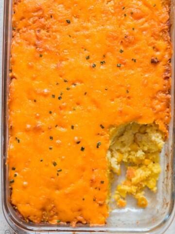 cheesy sweet corn casserole in casserole dish
