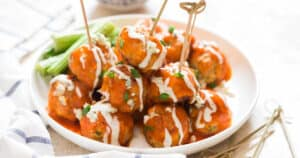 meatballs made of chicken with buffalo sauce and blue cheese dressing on top
