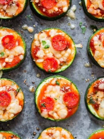 pizza bites with zucchini crust on baking tray with text overlay