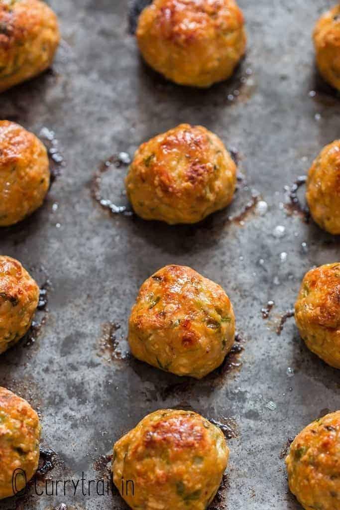 baked chicken meatballs on baking tray