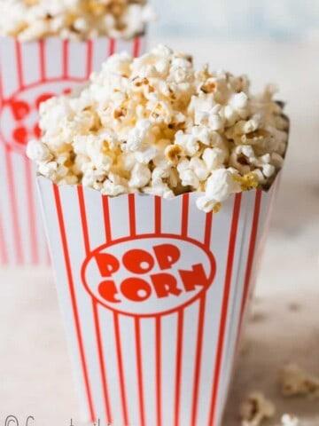 homemade movie popcorn in 2 popcorn tubs