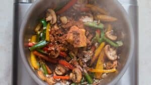 cooking veggies in skillet with spices