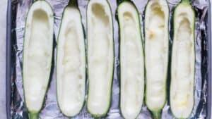 zucchini boats arranged on sheet pan
