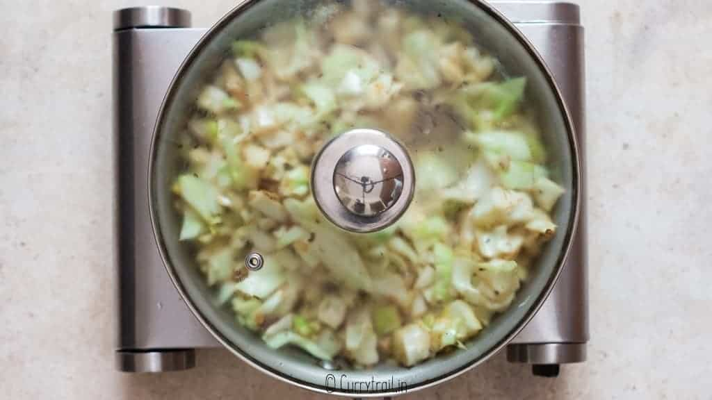 making fried cabbage in skillet pan