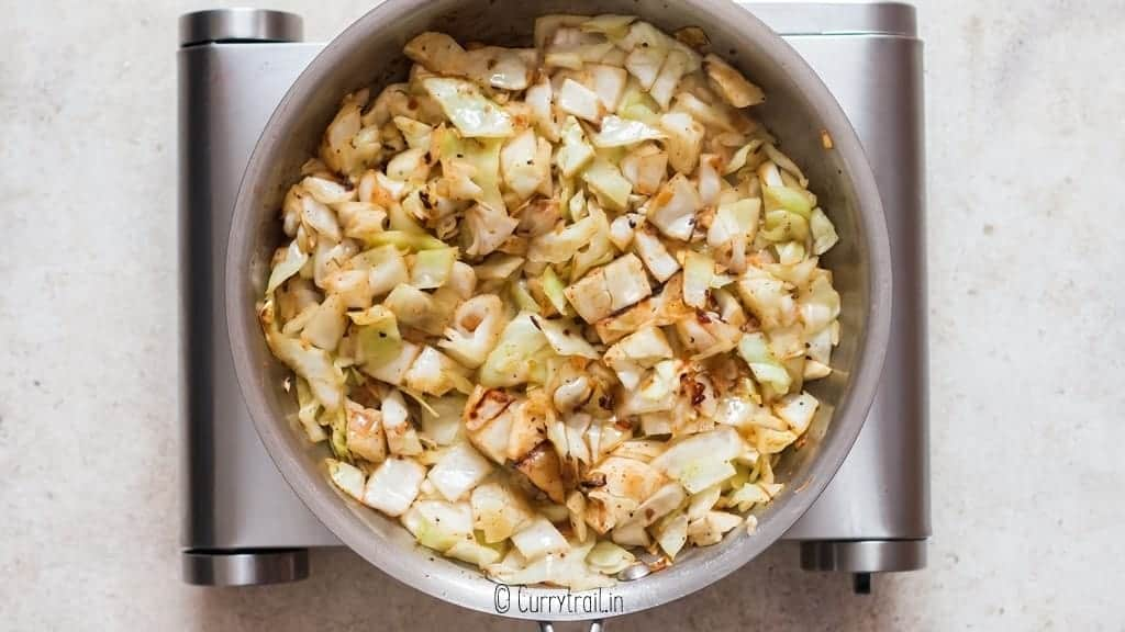 making fried cabbage in skillet until cabbage is softened