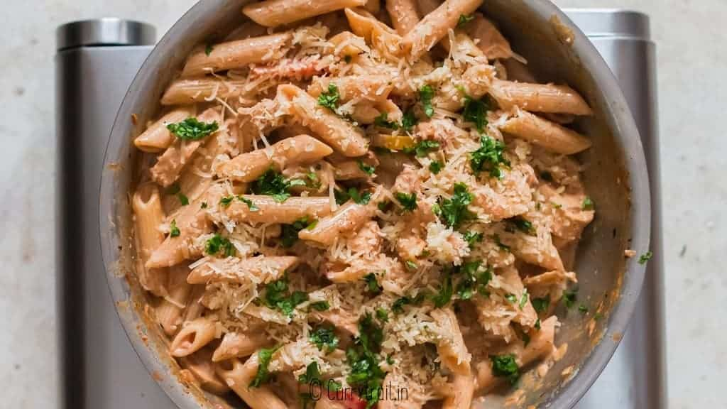 cajun chicken pasta garnished with parmesan cheese and parsley
