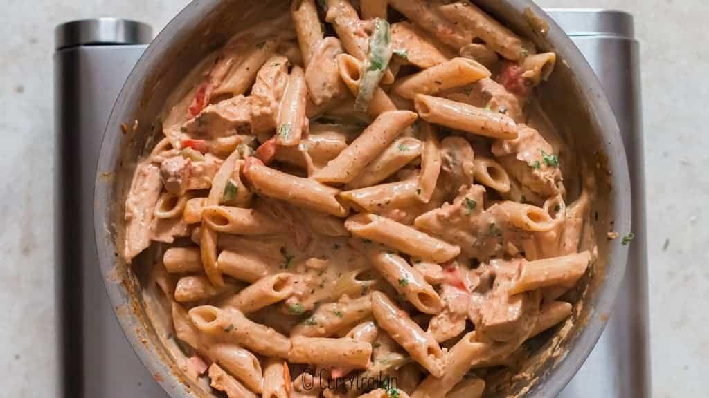 cooked pasta in vegetable cream sauce to make creamy cajun chicken pasta recipe