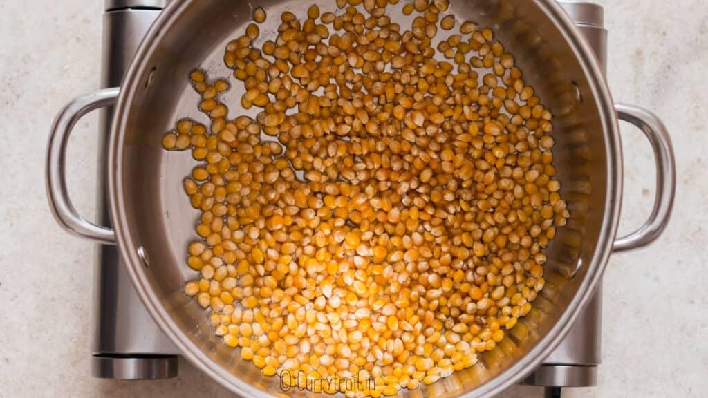 popcorn kernels in large pot to make movie style popcorn