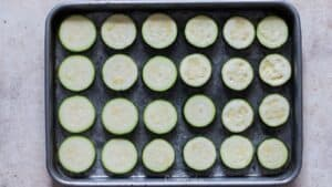 zucchini slices arranged on baking tray