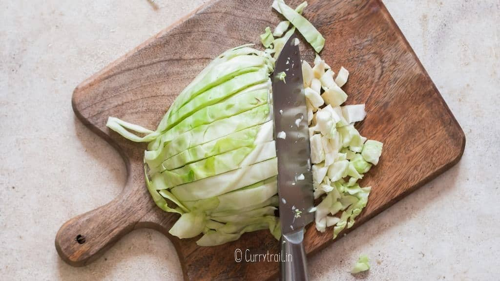 chopping cabbage into bite size pieces